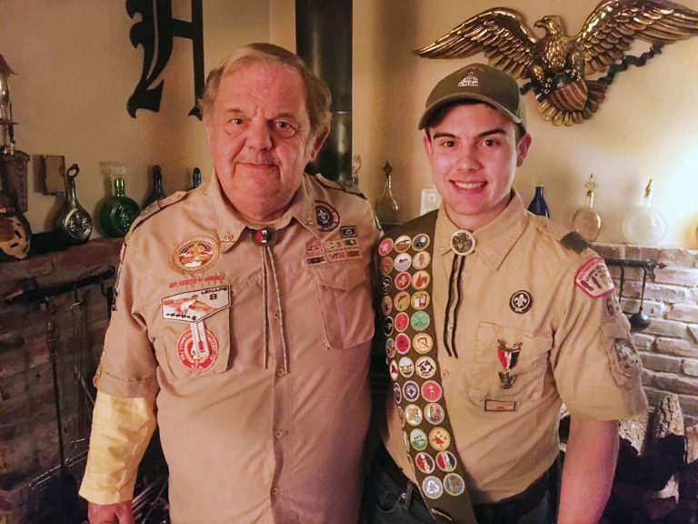 Grandfather awards his Eagle medal to grandson