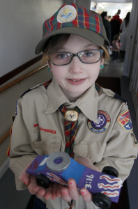 Female Cub Scout Celebrates Her First Official Pinewood Derby Experience